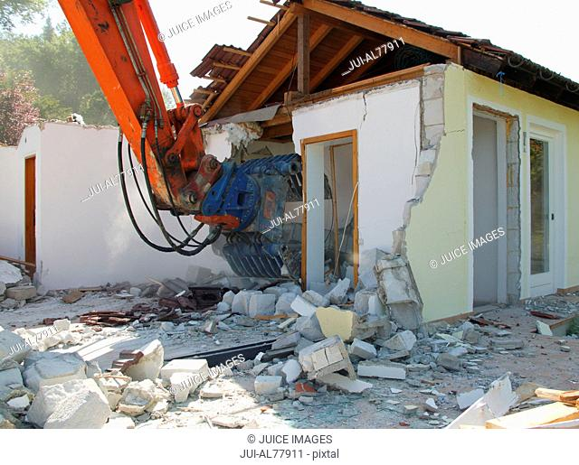 Machine destroying a house