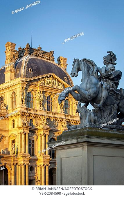 Equestrian statue of King Louis XIV at the entrance to Musee du Louvre, Paris France