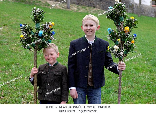 Two boys with palm branches, blessing of the palms, Palm Sunday, Holy Week, Easter, Bad Heilbrunn, Upper Bavaria, Bavaria, Germany