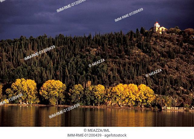 Lake, small church on the mountain , Kastoria, West Macedonia, Greece