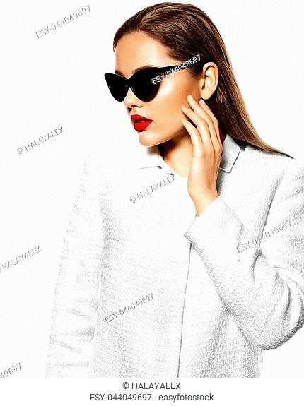 High fashion look.glamor closeup portrait of beautiful sexy stylish brunette business young woman model with bright makeup with red lips in white coat jacket...