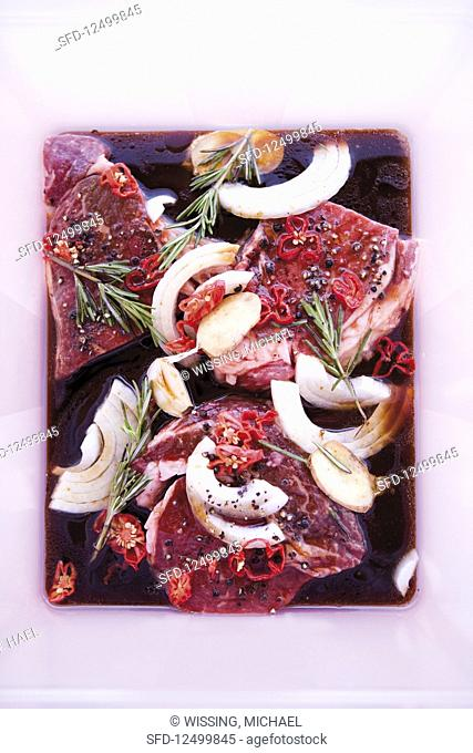 Beef in a red wine marinade with herbs and spices