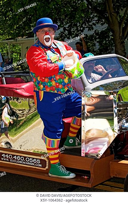 Clown handing out candy in a Memorial Day Parade