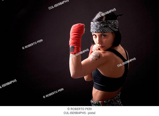 Portrait of young woman in fighting stance