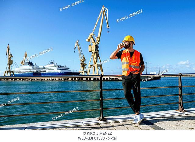 Port worker having a coffee break