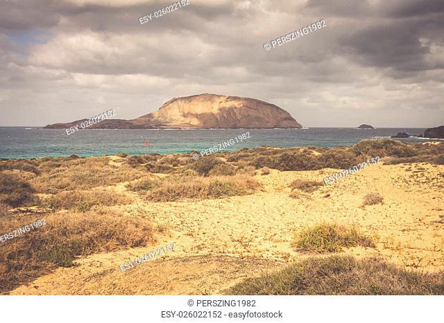 A view of Playa de Las Conchas, a beautiful beach on La Graciosa, a small island near Lanzarote, Canary Islands, in the middle of the Atlantic Ocean