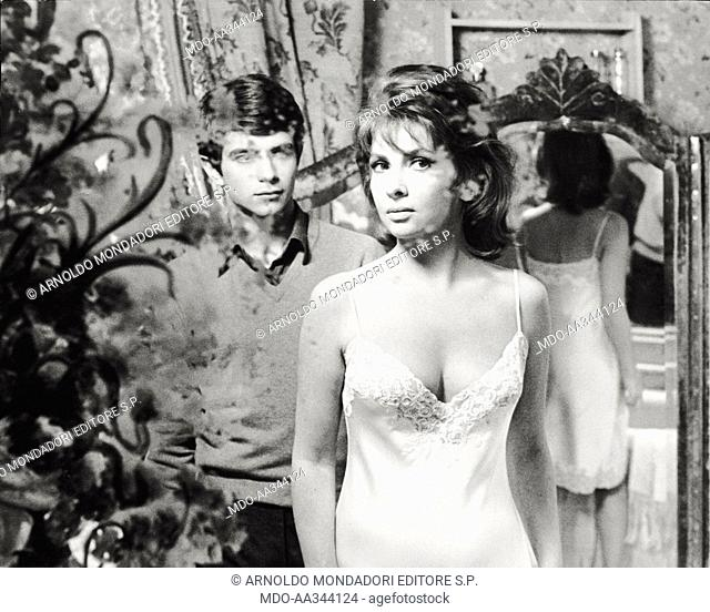 Gina Lollobrigida and Paolo Turco in a scene of the film. Italian actress Gina Lollobrigida, wearing a petticoat, acts with the Italian actor Paolo Turco in a...