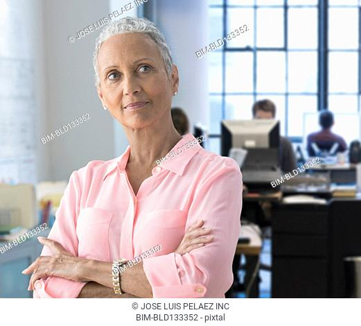 African American businesswoman thinking in office