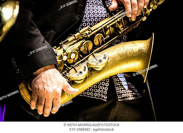 Jazz music : a musican playing a saxophone in a group