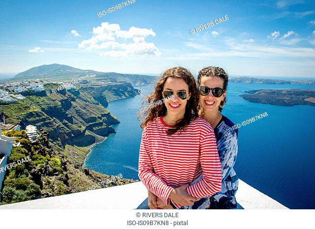 Mother and daughter hugging, sea in background, Oía, Santorini, Kikladhes, Greece