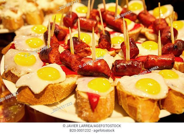 Quail egg and fried chistorra, Pintxos, Bar Taberna Aralar, Parte Vieja, Old Town, Donostia, San Sebastian, Gipuzkoa, Basque Country, Spain