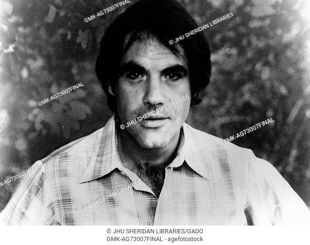 A headshot of American comedian, singer, and actor Robert Klein wearing a gingham collared shirt at Spring Fair, a student-run spring festival