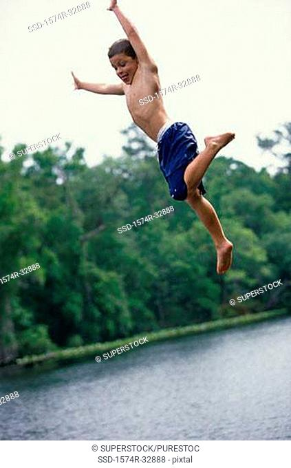 Low angle view of a boy jumping in water