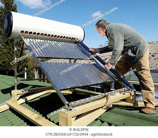 Inserting a solar panel tube to a frame