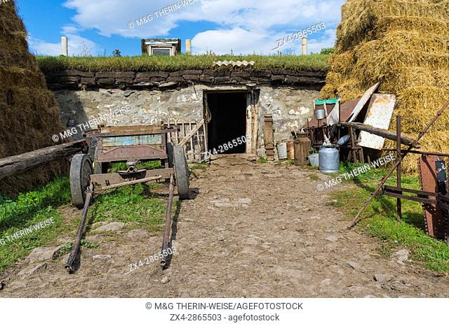 Old agricultural equipment, haystack and countryside house, Bokdajeni village, Georgia