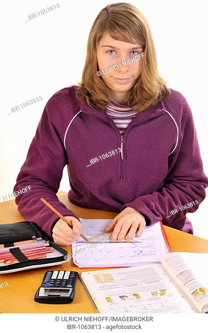 Teenager doing her maths homework
