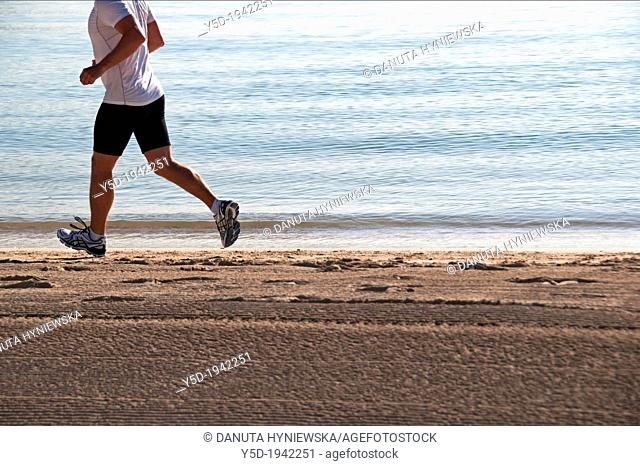single man jogging on the beach, Playa Muro, Mallorca, Balearic Islands, Spain, Europe