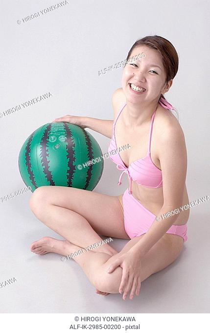 Young Woman Smiling with Watermelon Beach Ball