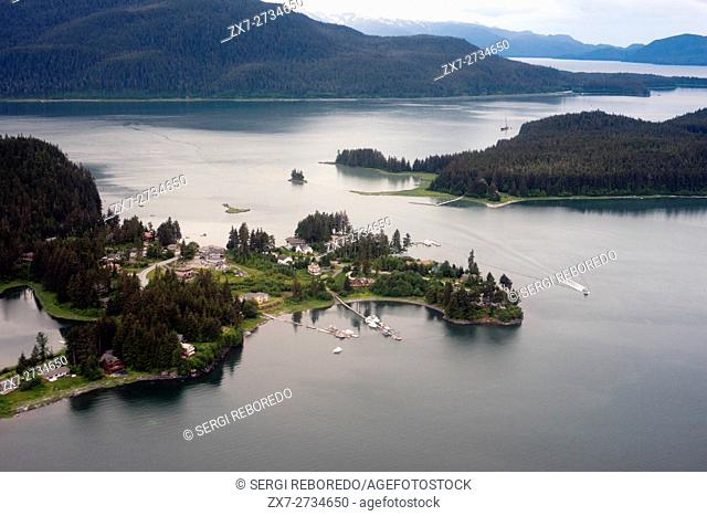 Aerial view of Coastal Mountains, houses, and glaciers north of Juneau, Southeast Alaska. Juneau has an amazing number of fully accessible mountains and ridges