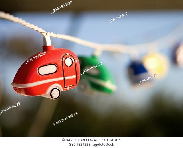 Festive lights shaped like travel trailers hang in Santa Barbara, California, United States