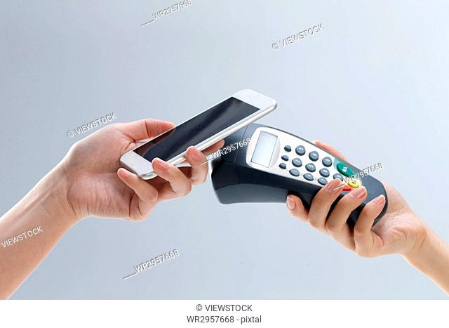 Hand holding mobile phone card