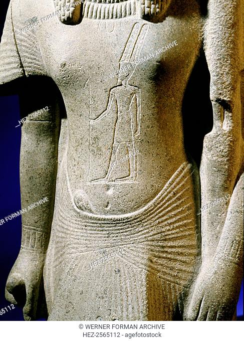 Statuette identified as either a priest of Hathor or of Mut, wife of the God Amun, found in the court of the temple of Amun at Karnak