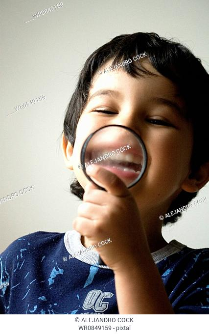Child Playing with a Loupe
