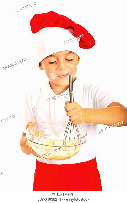 Cheerful little boy mixing dough isolated on white background