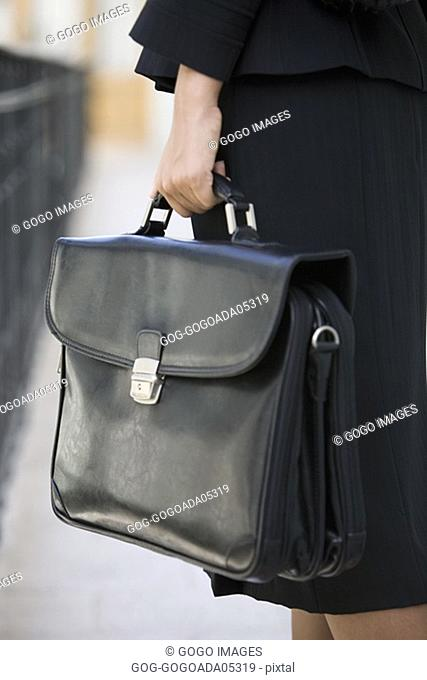 Businesswoman carrying a briefcase