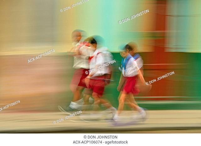 Street photography in central Havana- schoolchildren walking to the city school