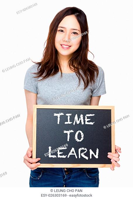 Woman hand hold with blackboard and showing phrase of time to learn