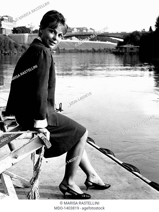 Gabriella Pallotta poses sitting on a bench along the river Tiber. The Italian actress Gabriella Pallotta poses for the photographer sitting on a bench in the...