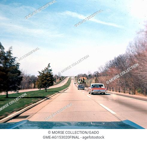 View from the front passenger seat of a car traveling southwest on the Wilbur Cross Parkway outside of New Haven, Connecticut, May, 1964
