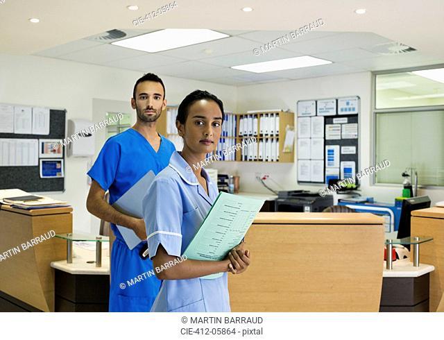 Nurses standing in hospital hallway