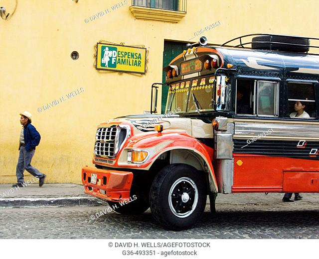 Former American school buses, which now serve as  Guatemala's local and long distance buses, some with old markings from their past lives in America