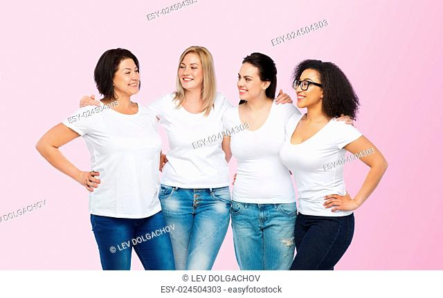 friendship, diverse, body positive, communication and people concept - group of happy different size women in white t-shirts hugging and talking over pink...