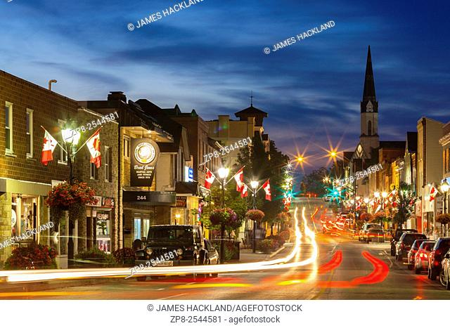 A view looking north from the bottom of Main Street at dusk. Downtown, Newmarket, Ontario, Canada