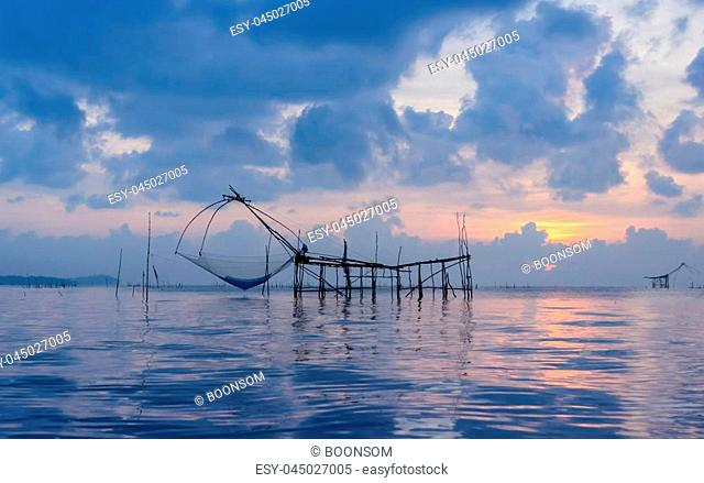 Beautiful sunrise seascape with Chinese fishing nets or shore operated lift nets in Phatthalung, Thailand