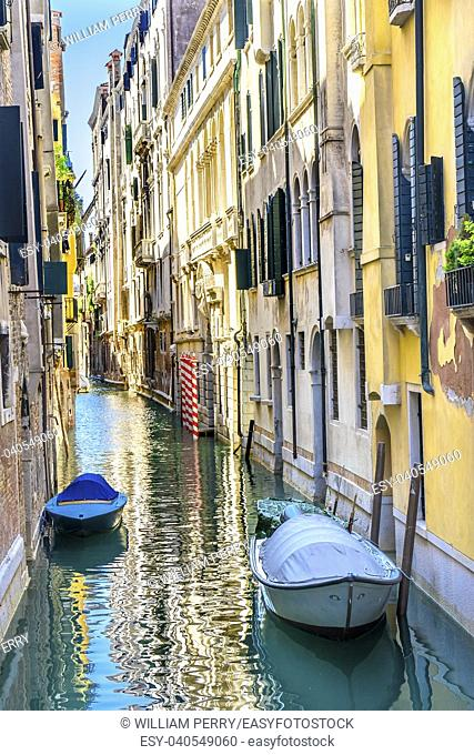 Colorful Small Canal Buildings Boats Poles Reflections Venice Italy