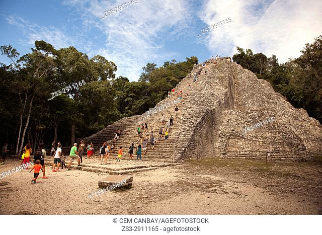 Tourists climbing up to the Nohoch Mul Pyramid at the Prehispanic Mayan city of Coba Archaeological Site, Quintana Roo, Mexico , Central America