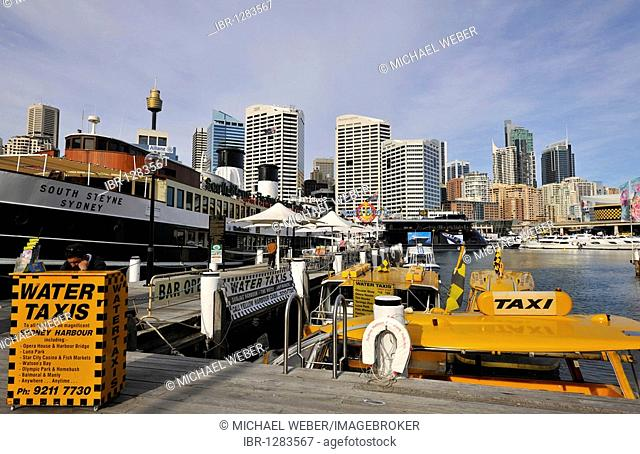 Water taxis in Darling Harbour in front of Sydney Tower or Centrepoint Tower and the skyline of the Central Business District, Sydney, New South Wales