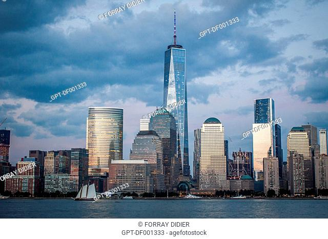 BLUE HOUR OVER THE SKYLINE OF THE FINANCIAL DISTRICT OF NEW YORK WITH ONE WORLD TRADE CENTER DOMINATING THE CITYSCAPE, VIEW FROM JERSEY CITY, MANHATTAN