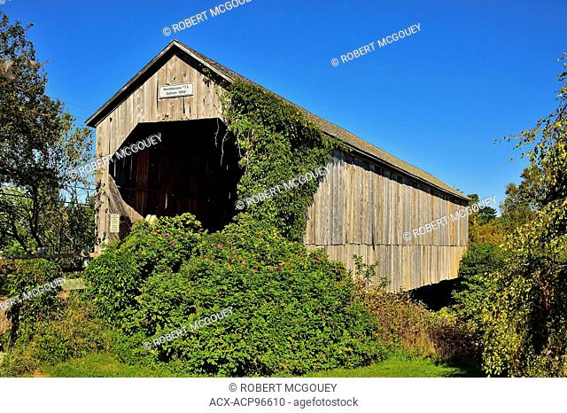 A horizontal view of a covered bridge built in 1908 to cross a section of river near Smith Creek, New Brunswick, Canada
