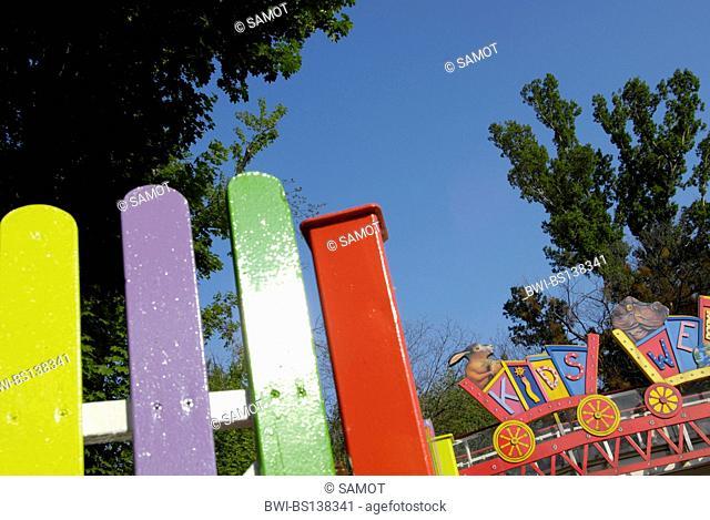 children corner with colourful wooden fence in the amusement park Vienna Prater, Austria