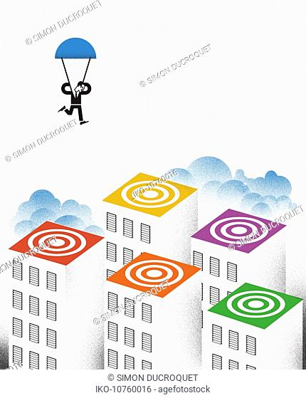 Man with parachute landing on colorful rooftop