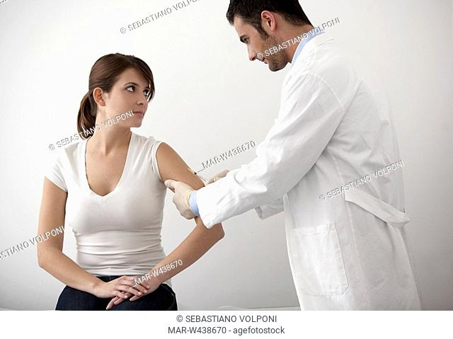 male doctor and female patient, injection
