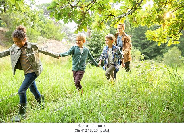 Students and teacher walking outdoors