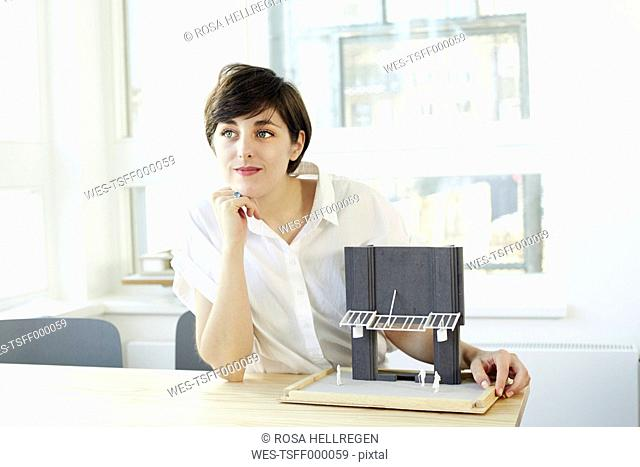 Portrait of architect with architectural model