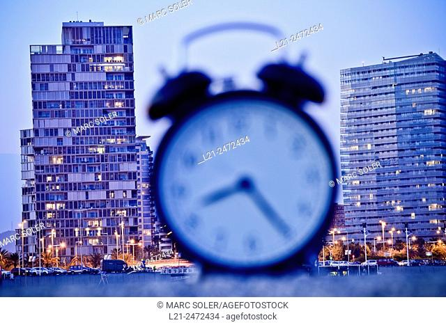 Blurred alarm clock and skyscrapers in the background. Barcelona, Catalonia, Spain