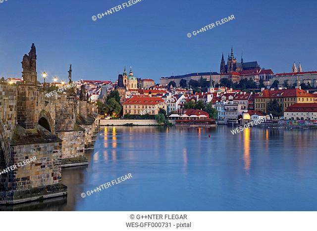 Czech Republic, Prague, Old town, Charles Bridge, Prague Castle and St. Vitus Cathedral in the evening